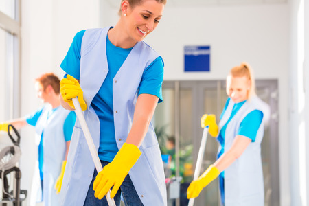 Photo for Commercial cleaning brigade working mopping the floor - Royalty Free Image