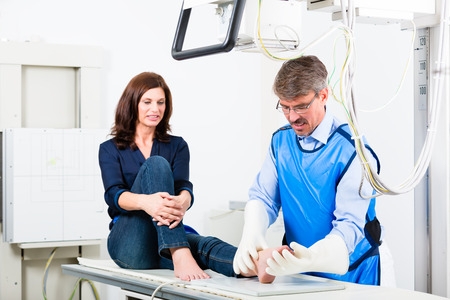 Orthopedist doctor making x-ray of patient leg in surgery