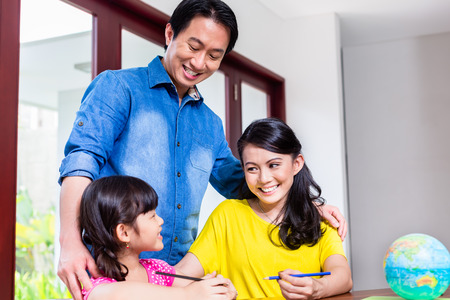 Chinese family teaching mathematics to their child