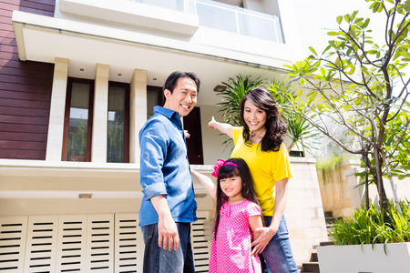Chinese Family in front of house in residential area in Asia