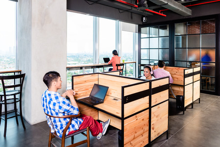 Photo pour Start-up business people in coworking office working in cubicles - image libre de droit