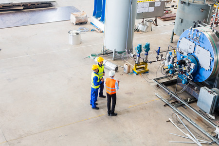 Photo for Industrial team of Worker and engineer discussing at machine in factory - Royalty Free Image