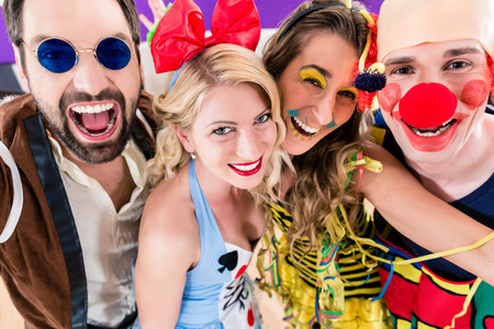 Photo pour Party people celebrating carnival or new years eve - image libre de droit