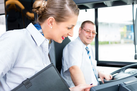 Bus or coach driver and tourist guide