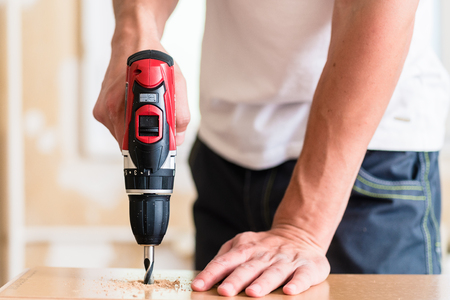 Photo pour Craftsman or DIY man working with power drill - image libre de droit