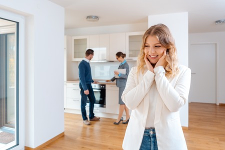 Photo for Woman raving about the apartment she and her man are going to rent or purchase - Royalty Free Image
