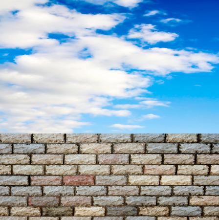 decorative  brick fence wall against blue sky