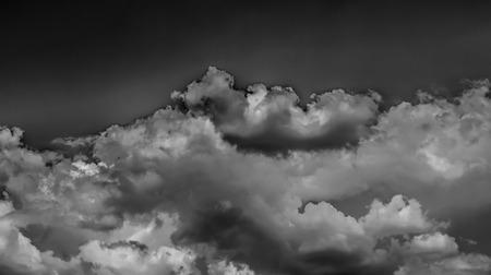 Photo pour White clouds on a dark sky, monochrome. - image libre de droit