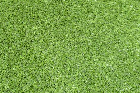 Foto de Texture of green grass, field with artificial turf for football, background. - Imagen libre de derechos