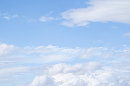 Photo pour White clouds in the blue sky. Clouds are suspended in the atmosphere condensation of water vapor. - image libre de droit