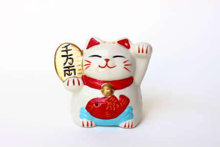 Japanese lucky cat on white