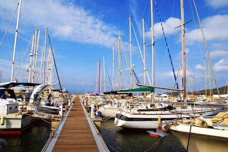 Photo for Pleasure boats moored at the harbor along a pontoon. - Royalty Free Image