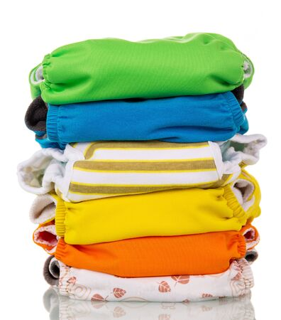 Photo for A stack of multi-colored modern eco-friendly diapers is isolated on a white background. - Royalty Free Image
