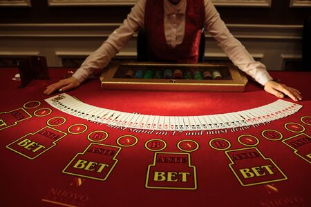 Photo pour The croupier in the casino does a shuffle of cards at the table. Gambling - image libre de droit