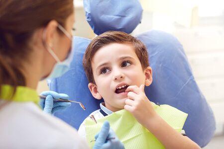 Foto de A child with a dentist in a dental office. Dental treatment in a childrens clinic. - Imagen libre de derechos