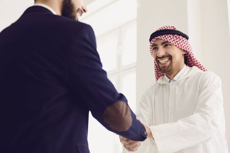 Photo pour Handshake of arabic and european businesspeople. Businesspeople hands makes a handshake in the office. The conclusion of the contract by business people. - image libre de droit