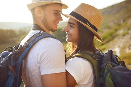 Photo for Couple with backpacks on hikking the nature. Travel,tourism,people,backpack concept - Royalty Free Image