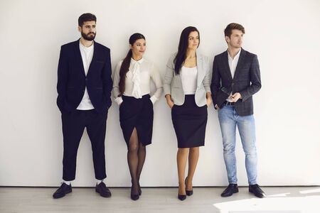 Photo pour Group of young business people team standing teamwork on the background. Concept meeting businessmen business women analytics startup idea strategy team. - image libre de droit