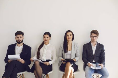 Photo pour Business people waiting for job interview recruitment sitting on a chair in the office. Employee office worker people recruitment concept. - image libre de droit