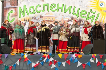 PODOLSK, OSTAFIEVO, RUSSIA - FEBRUARY 21: Unidentified people of folk collective Istok on Russian religious and folk holiday Maslenitsa in estate Ostafievo on February 21, 2015, near Podolsk, Russia