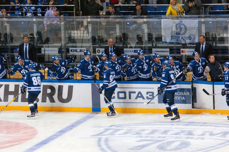 MOSCOW, RUSSIA - OCTOBER 12, 2016: Unidentified players of Dynamo rejoice of score on hockey game Dynamo Moscow vs Slovan Bratislava on Russia KHL championship. Slovan won 5:3