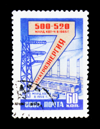 MOSCOW, RUSSIA - JUNE 26, 2017: A stamp printed in USSR (Russia) devoted to Electricity production and shows Industrial area with plants and towers, circa 1958