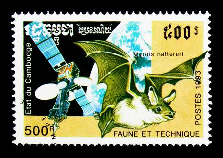 MOSCOW, RUSSIA - NOVEMBER 24, 2017: A stamp printed in Cambodia shows Natterer's Bat (Myotis nattereri), Satellite, Fauna and Technics serie, circa 1993