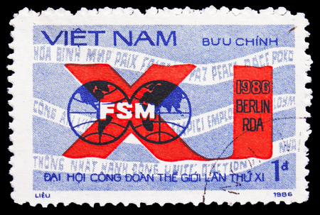 MOSCOW, RUSSIA - FEBRUARY 21, 2019: A stamp printed in Vietnam shows FSM emblem, 11th World Trade Unions Congress serie, circa 1986