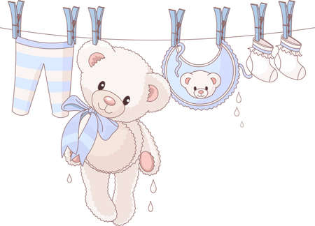Cute Teddy bear after washing hanging between baby laundry on a rope