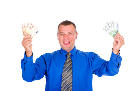 Closeup portrait of happy, smile, successful, lucky businessman in blue shirt and tie. Holding money euros banknotes with hands up. Isolated white background. Positive emotion