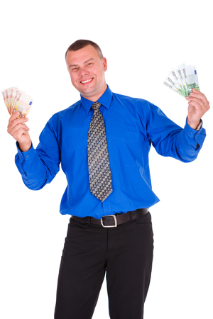 Full length portrait of happy, smile, successful, lucky businessman in blue shirt and tie. Holding money euros banknotes with hands up. Isolated white background. Positive emotion