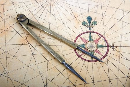 Ancient brass dividers on a nautical chart