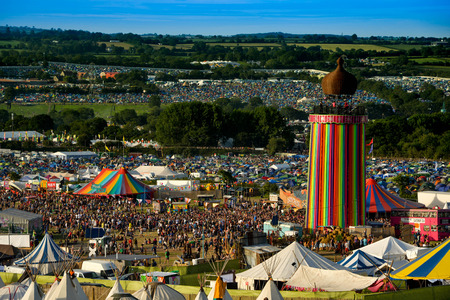 Photo for Panoramic view from the top of the hill over the entire Glastonbury Festival site, including the Ribbon tower, the Other Stage and Pyramid stage - Royalty Free Image