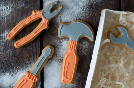 Photo for Ginger biscuit tools and icing sugar on wooden background. Top view. Ginger cookies. - Royalty Free Image
