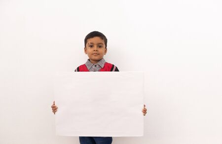 Photo for Concept of child protest showing with young boy holding large white placard on isolated background - Royalty Free Image