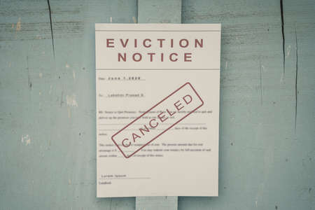 Photo pour Canceled Foreclosed or eviciton notice on a main door with blurred details of a house with vintage filter - image libre de droit