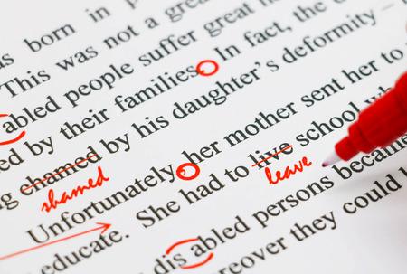 Photo pour closeup red marks on proofreading english document - image libre de droit
