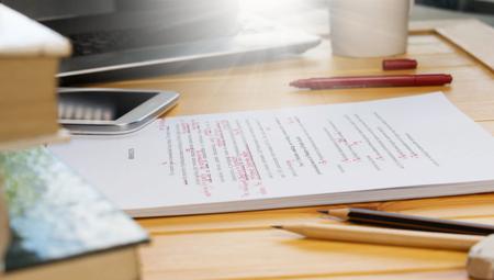 Photo pour proofreading text on table in office - image libre de droit