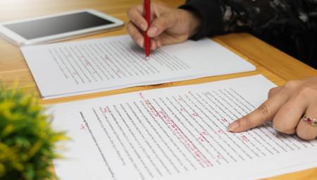 Photo pour Hand working on paper for proofreading - image libre de droit