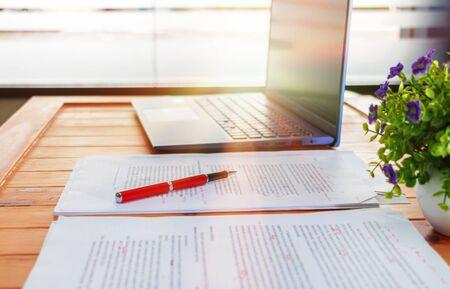 Photo pour concept of proofreading with pen, blur text and laptop on desk in office - image libre de droit