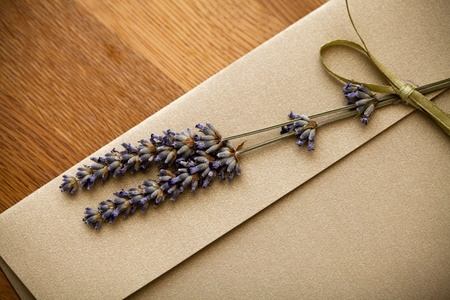 Close up of an invitation envelope decorated with lavender
