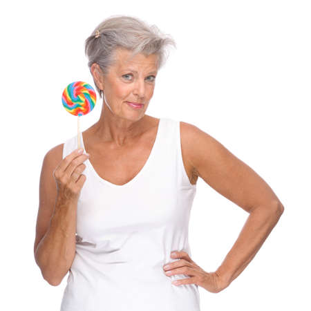 Photo for Full isolated portrait of a senior woman with lolly - Royalty Free Image