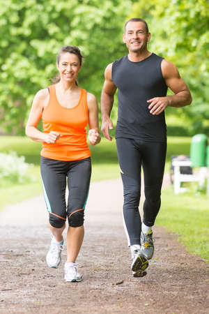 Sport couple running in park