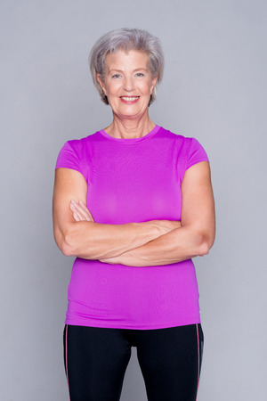 Photo for Portrait from a sportive senior woman in front of gray background - Royalty Free Image