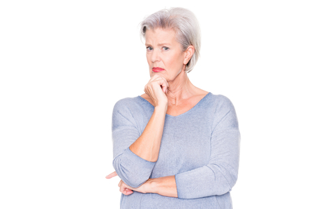 Photo for Senior woman ist amazed about something in front of white background - Royalty Free Image
