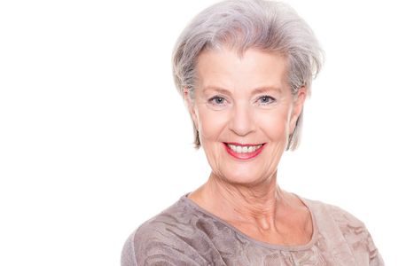 Photo for Happy and successful senior woman with pullover in front of white background - Royalty Free Image