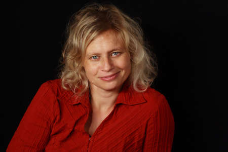 portrait of a blond woman wearing red shirt