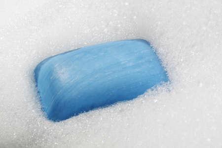 blue soap bar over bubble bath