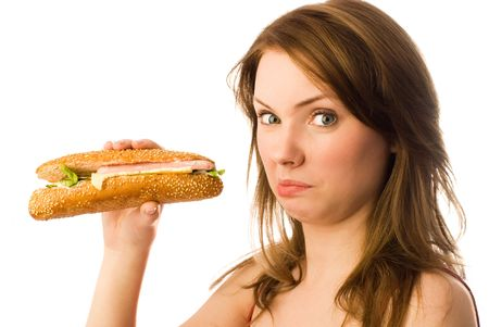 beautiful young woman shows her disgust to fast food