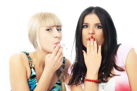 portrait of two girls, one of them is smoking a cigarette and the other shows her surprise and disgust